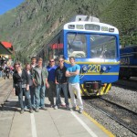 All aboard!  Standing in front of our Peru Rail train in the Ollantaytambo Station