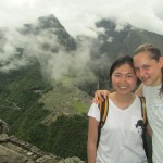 Standing near the top of Huayna Picchu, with Machu Picchu citadel in the background