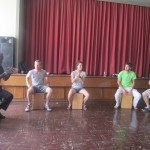 Camilo instructs the students in the art of percussion