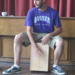 Striking the cajon near the middle produces a deep, full sound