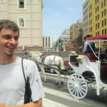 Standing near a horse-drawn carriage reminiscent of Peru's colonial period -- Spain's king sent a vice-king (viceroy) to Lima soon after the conquest to rule his newly-acquired colony