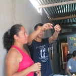 Eliana and Ricardo explain the origin of each seed and how the beads are prepared