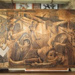 A wood carving depicting the war between Shining Path terrorists and government soldiers