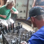 Trying out the chess set -- the pieces are carved from stone