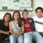 Waiting at the bus station with members of his host family (from left): Betty, Grecia and Marco