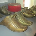 These shoes were actually worn as stirrups to protect riders from thorns, and perhaps also from swords