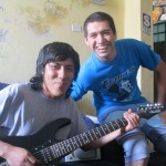 With his host brother, Caleb, who plays electric guitar