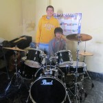 With Diego, who is learning to play this new drumset
