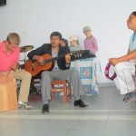 Playing a Quechua praise song
