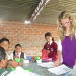 Kate designs worksheets each day to give the students a chance to practice their English