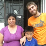 Outside the front door of his host family's home with his mother, Nieves, and brother, Javier