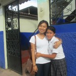 Jieun, at the entrance to the INABIF center, with one of her new friends