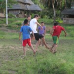 The village boys play soccer each afternoon