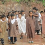 The children line up outside the school