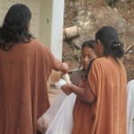 Afterwards, handing out government-issued milk and bread, part of a national nutrition program