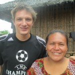 With his host mother, Irma