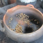 The coffee beans are roasted in a clay pot over a wood fire