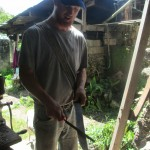 Sharpening a machete -- the people around here do not go anywhere without their favorite tool