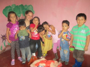 With a group of children in her class