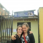 Emma and Mandy in front of the church that hosts the Compassion International after-school program