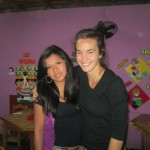 Emma with one of the tutors in the Compassion program