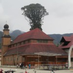This Catholic church is built entirely of wood, with a steeply-sloped roof in the Austrian style