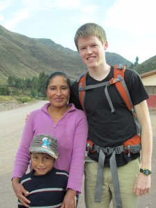 With his host mother, Luisa, and brother, Urias