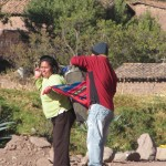 Bringing another suitcase, the Andean way -- mantas are used to carry anything from potatoes to small children