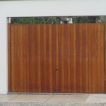 Even the garage doors are opulent -- this is one of many on this street fashioned from polished rain forest hardwoods