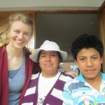 With members of her host family, Luz and Fabricio