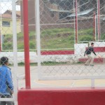 The local soccer field, or court since it's constructed of concrete, is a favorite place among the children of Winpillay