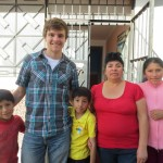 With his host family (from left): cousin Miguel, brother Javier, mother Nieves and cousin Zueli