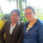 With one of the two teachers she assists, Miss Miriam