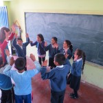 The children are eager to learn English with a native speaker