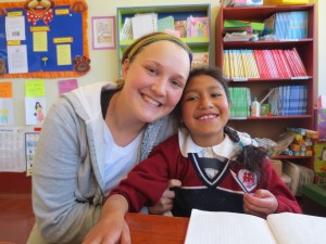 Megan begins her day assisting Katy, a special-needs child, with her assignments
