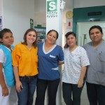 With members of the staff on the clinic's first floor
