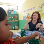Communicating with two of the students using sign language