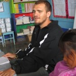 Clayton's assignment is to teach basic English to the youngest children in the village primary school