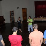 Lisette Alcantara and Pedro Farias begin instructing students about traditional Peruvian dances.