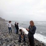 Students enjoy a visit to the Pacific Ocean. Most dipped their hands in the chilly waves.