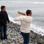 Joshua and Rudy try skipping stones in the chilly ocean.