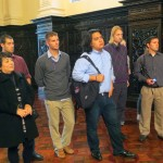Celia Vasquez, Goshen College's study coordinator in Peru, and students examine the Great Hall in the Government Palace. The hall can accommodate 250 people for state dinners.