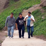 Alan, Jacob and Rudy climb the long stairway from the beach to the Malecon park.