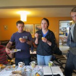 Joshua, Becca and Landon sample fruit from Peru.