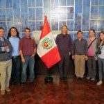 GC students Alan, Jacob, Rudy, Landon, Joshua, Becca and Lauren pose beside the Peruvian flag in the Government Palace.