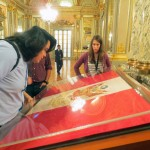 Jacob, Rudy and Lauren examine the flag of the presidential guard in the Golden Hall, which was inspired by the Hall of Mirrors in the Palace of Versailles. Its walls are covered in gold leaf.