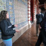 A tour guide at Santo Domingo shows students Spanish tile that date back to the 17th century.