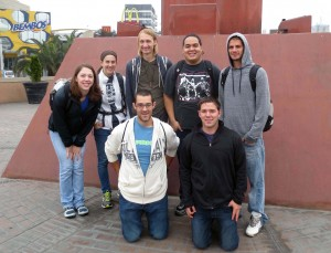 Goshen College students pause in Ovalo Gutierrez for a group photograph. Ovalo Gutierrez,  a large traffic circle surrounded by businesses, is a center of commercial life in the Miraflores and San Isidro districts of Lima.