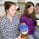 Becca and Lauren prepare to sample an herbal tea.