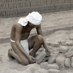 A depiction of how clay and adobe bricks were made at Huaca Pucllana.